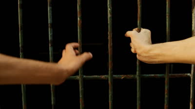 hands on jail bars
