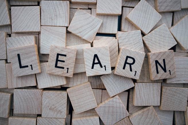 """Scrabble wooden blocks spelling """"learn"""""""