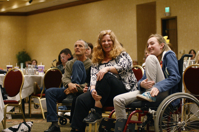 a group of people participating in wheelchair yoga