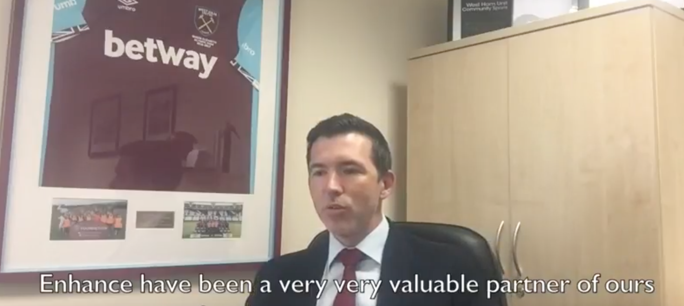 A screen shot of a member of the west ham foundation speaking about his experience working with Enhance the uk