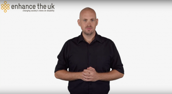 a bald man talking in BSL about the sex and disability campaign
