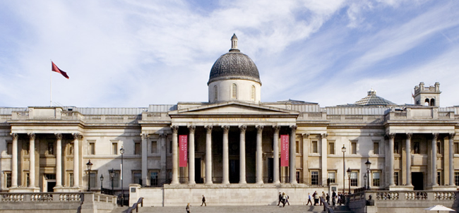 The national gallery with a lovely blue sky and a small crowd of people waiting outside