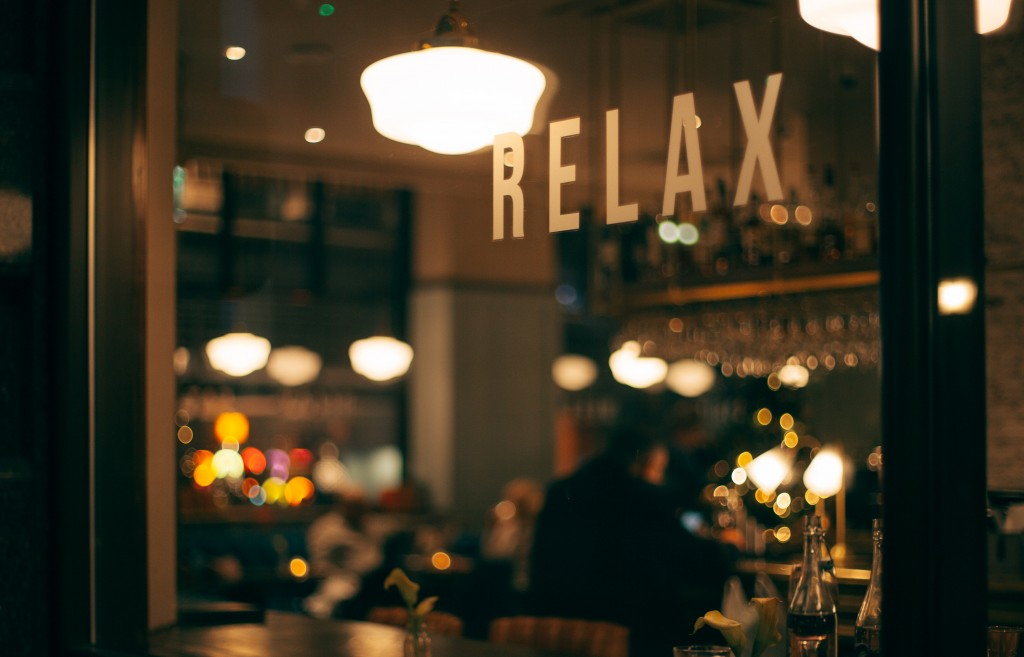 a trendy bar with the 'relax' printed on the window