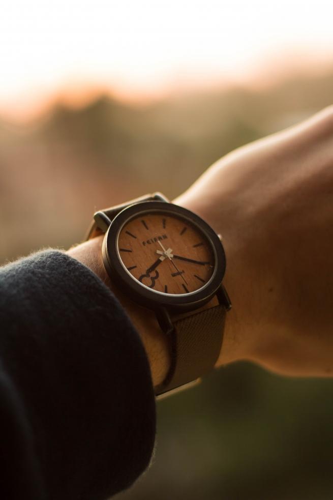 a woman wearing a brown watch