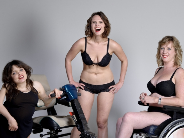 Three woman with various disabilities in their underware