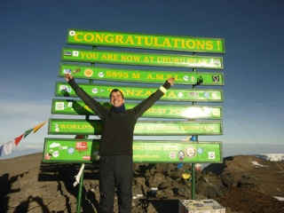 Paul Nicol at the top of Mount Kilimanjaro
