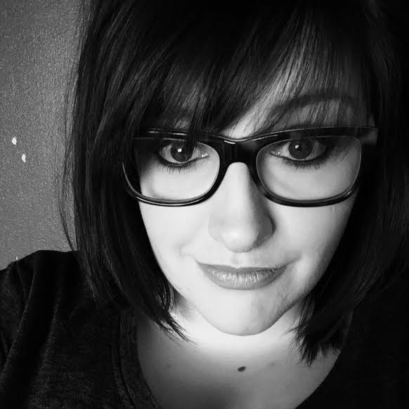 Sarah Alexander in black and white wearing glasses