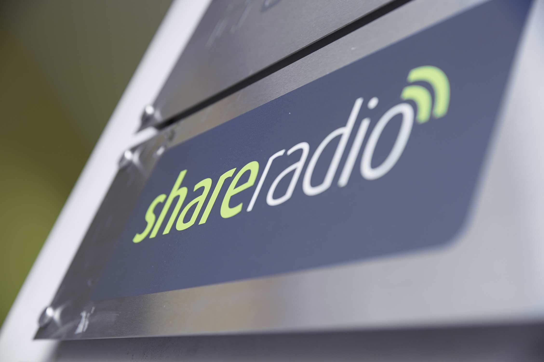 Share Radio logo on a sign