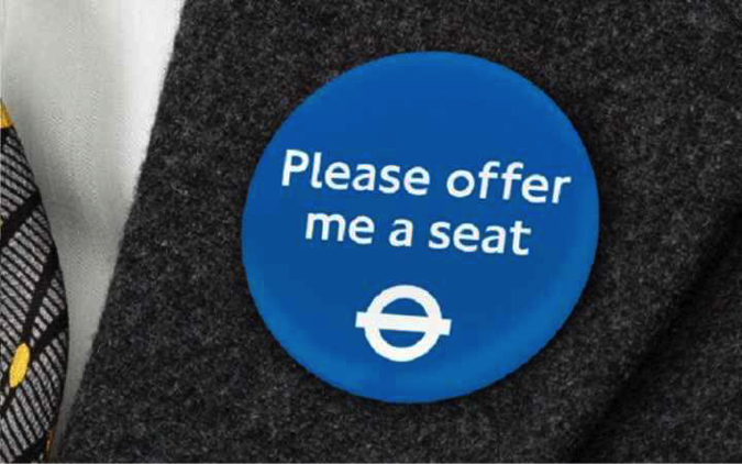 """please offer me a seat"" sticker in london underground"