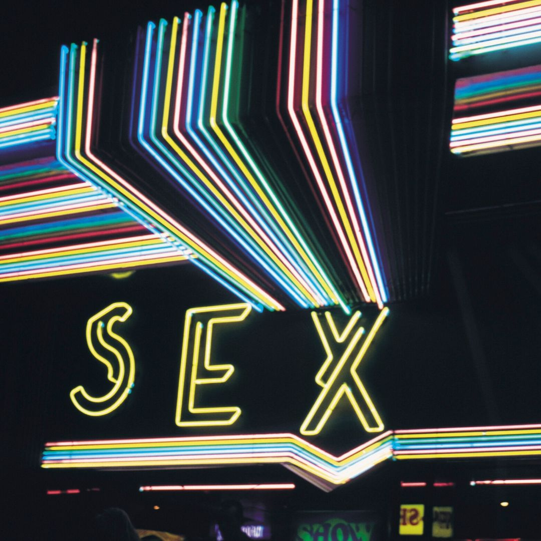 A neon sign that spells out the word Sex