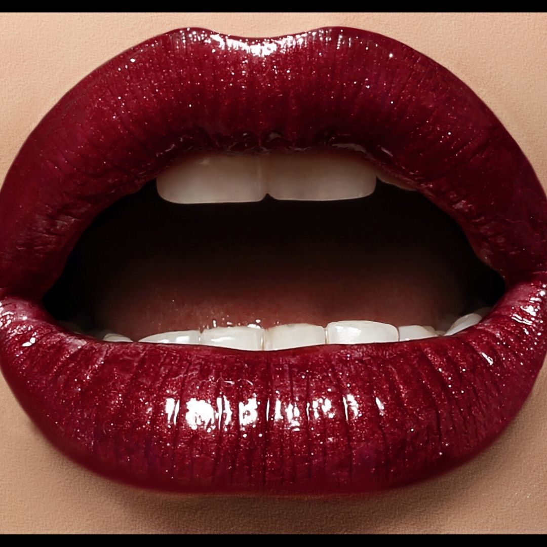 Inclusive Erotica - Deep red glossy lipstick painted on to an open mouth